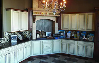Kitchen remodels from backsplash to tile floor by George's Carpet & Tile
